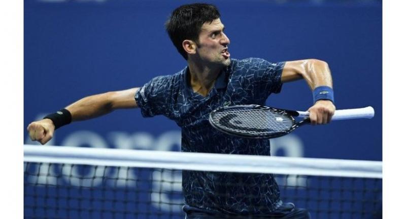 Serbia's Novak Djokovic celebrates after defeating Australia's John Millman.