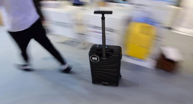 The I-porter suitcase is pictured at the booth of BG Berlin during the IFA in Berlin. / AFP