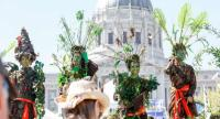 Women dressed as trees with the group The Forgotten Solution, join the crowds at Civic Center Plaza after marching at the 'Rise For Climate' global action on September 8, 2018 in downtown San Francisco, California.//AFP