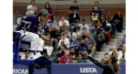 Serena Williams of the United States reacts to umpire Carlos Ramos after her defeat in the Women's Singles finals match to Naomi Osaka .