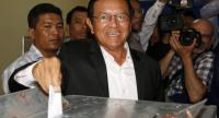 This file photo taken on June 04, 2017 shows Kem Sokha, leader of the Cambodia National Rescue Party (CNRP), casting his ballot at a polling station in Phnom Penh./AFP