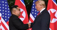 File photo : North Korea's leader Kim Jong Un (L) shakes hands with US President Donald Trump (R) at the start of their historic US-North Korea summit, at the Capella Hotel on Sentosa island in Singapore on June 12.//AFP