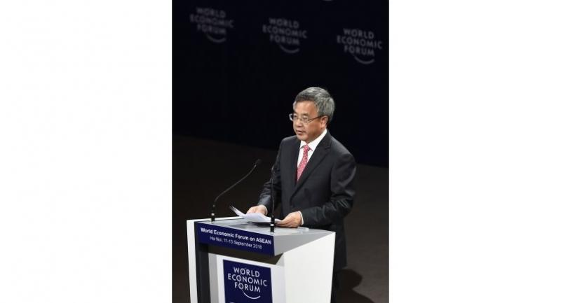 Chinese Vice Premier Hu Chunhua delivers his address at the opening of the World Economic Forum on ASEAN at the National Convention Center in Hanoi on September 12, 2018./AFP