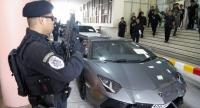 "Police guard a luxury car seized from Alexandre Cazes, founder of the ""darknet"" marketplace AlphaBay."