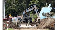 Self-Defense Force personnel remove earth and sand on a road closed to traffic in Atsuma, Hokkaido, on Friday morning./The Japan News