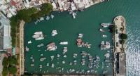 An aerial view shows boats in a 'typhoon shelter' next to the flood prone coastal village of Lei Yu Mun, two days before the expected arrival of Super Typhoon Mangkhut in Hong Kong on September 14, 2018./AFP
