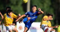 Atsada Homhual vies for the ball against Toyota City  players.