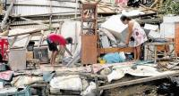 STORM'S FURY Lydia Domingo and her nephew, Marwin Palacio, pick up the pieces after the powerful typhoon destroyed their house at Barangay San Lorenzo, Lallo town, Cagayan province, when it barreled through northern Luzon. —RICHARD REYES