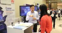 A staff explains about Huawei products and solutions at a booth at Myanmar Connect 2018.