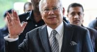 File photo :  In this file photo taken on August 10 Malaysia's former prime minister Najib Razak waves as he arrives for a court appearance at the Duta court complex in Kuala Lumpur. //AFP