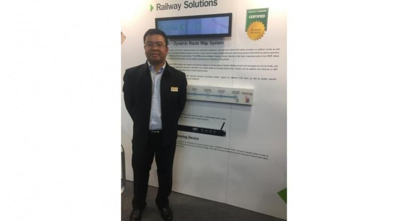 AMR Asia Co Ltd's managing director, Marut Siriko, at his booth at InnoTrans 2018 in Berlin, Germany.