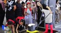 Children learn about agricultural technology at the 2018 World Internet of Things Expo in Wuxi, Jiangsu province. The four-day expo opened on Saturday. XIAO DA/CHINA DAILY