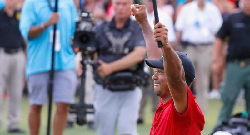 Tiger Woods of the United States celebrates making a par on the 18th green to win the TOUR Championship at East Lake Golf Club on September 23, 2018 in Atlanta, Georgia. Kevin C. Cox/Getty Images/AFP