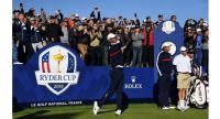 US golfer Tiger Woods (L) tees off as teammate US golfer Phil Mickelson looks on during a practice session ahead of the 42nd Ryder Cup at Le Golf National Course at Saint-Quentin-en-Yvelines.