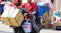 A JD delivery man in Taicang, Jiangsu province. [Photo by Xu Huaxin / for China Daily]