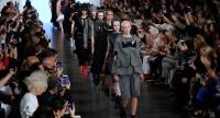 Models walk down a catwalk at a fashion show. In a separate report titled