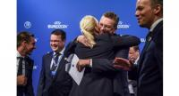 German Football Association (DFB) president Reinhard Grindel (2ndR) is congratulated by a member of the German bid delegation after it was announced that Germany was elected to host the Euro 2024 fooball tournament.