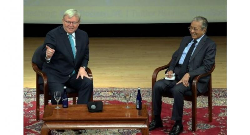 Dr Mahathir (right) with former Australian Prime Minister Kevin Rudd who was the moderator during a dialogue at the Asia Society while in New York.