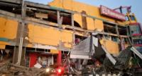 This handout photograph taken and released on September 28, 2018 by Indonesia's National Agency for Disaster Management (BNPB) shows a collapsed shopping mall in Palu, Central Sulawesi, after a strong earthquake hit the area./AFP