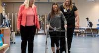 Susan Harkema, left, associate scientific director of the Kentucky Spinal Cord Injury Research Cent4re at the University of Louisville, with Kelly Thomas, who was paralysed in a car accident and is learning to walk.
