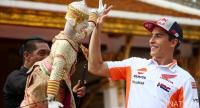 Marc Marquez plays with a traditional Thai puppet named Hanuman from Ramayana epic poem at Wat Ratchanatdaram temple in Bangkok.  Photo by  Tanachai Pramarnpanich