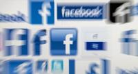 In this file photo taken on March 22, 2018 A computer screen displays logos associated with the social networking site Facebook, taken in Manchester, England./AFP