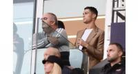 Suspended Juventus' Portuguese forward Cristiano Ronaldo (R) watches the UEFA Champions League group H football match between Juventus and Young Boys from the tribune.