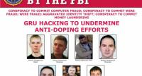 This image obtained from the FBI in Washington, DC, on October 4, 2018, shows seven suspected agents of Russia's GRU on a 'Wanted' poster after being indicted for hacking. /AFP