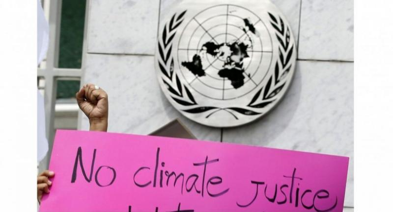 A climate change activist holds a placard during a demonstration outside the United Nations (UN) Centre during the first day of the UN Climate Change Negotiating sessions in Bangkok, Thailand, 04 September 2018. // EPA-EFE PHOTO