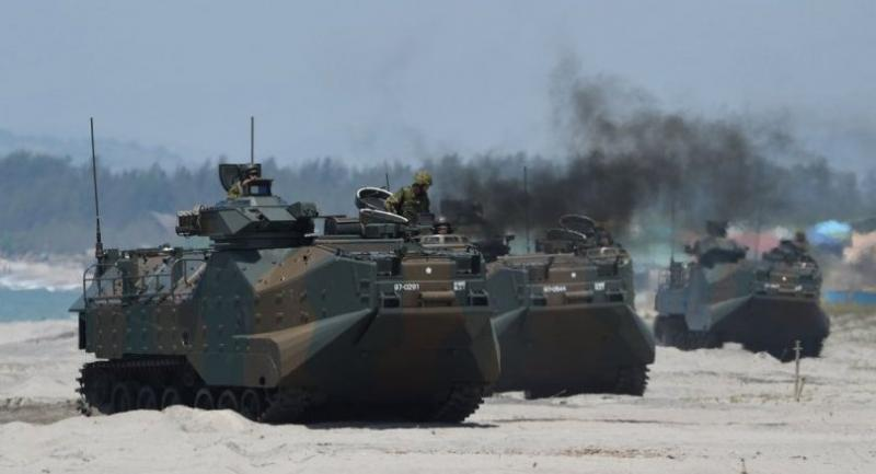 Japanese Ground Home Defence Forces' amphibious assault vehicles (AAV) hit the beach during an amphibious landing exercise at the beach of the Philippine navy training center facing the south China sea in San Antonio town, Zambales province./AFP