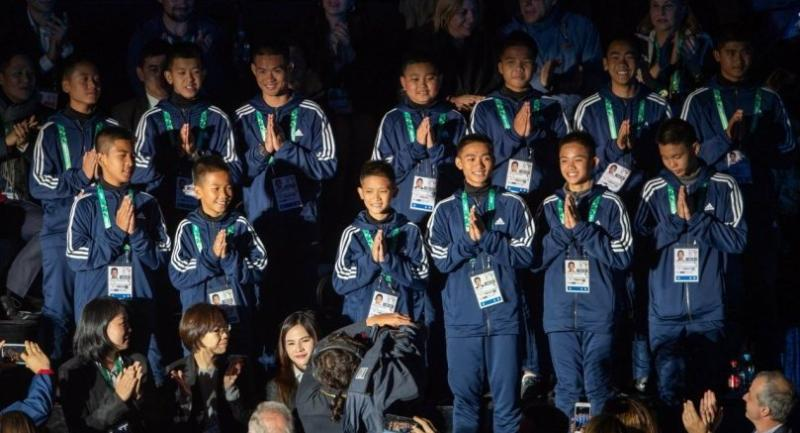 A handout photo made available by OIS/IOC shows The Thai youth football team 'The Wild Boars', who were rescued from Tham Luang cave in Thailand, stand during the Opening Ceremony of The Youth Olympic Games, in Buenos Aires, Argentina. Photo EPA