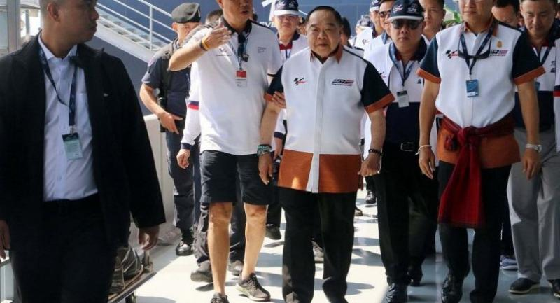 Deputy Prime Minister Prawit Wongsuwan, centre, with Minister of Tourism and Sports Weerasak Kowsurat, left, and Newin Chidchob, right, on their visit to the Buriram circuit.