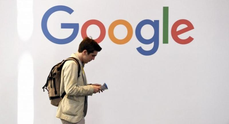 In this file photo taken on May 24, 2018 A man walks past the logo of the US multinational technology company Google during the VivaTech trade fair ( Viva Technology), in Paris./AFP
