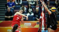 Hande Baladin of Turkey spikes the ball to the Thai defenders.