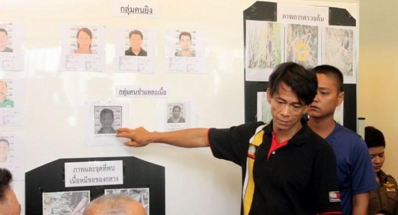 Tata, a Myanmar national, points to a photo of Chira, who was the alleged butcher of a bearcat that Tata admitted to having shot during a night hunt in Sai Yok National Park in Kanchanaburi province early this month.