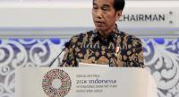 Indonesia President Joko Widodo delivers his speech at the International Monetary Fund (IMF) and World Bank annual meetings in Nusa Dua, on Indonesia's resort island of Bali on October 12, 2018. (Photo by SONNY TUMBELAKA / AFP)