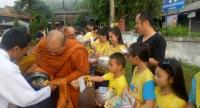 Mae Hong Son people give alms to monks Saturday morning to mark the second anniversary of His Majesty King Bhumibol Adulyadej's passing.