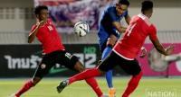 Teerasil Dangda blasts a shot past Trinidad and Tobago's players. Photo by Wanchai Kraisornkhajit