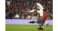 England's midfielder Marcus Rashford (L) vies with Spain's defender Jonny.
