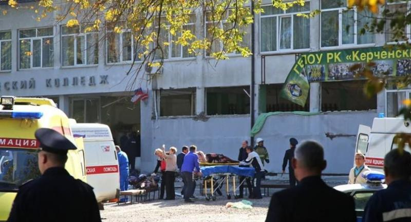 Rescuers carry an injured victim of a blast at a college in the city of Kerch on October 17.//AFP