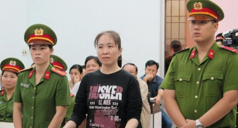 This file photo taken on November 30, 2017, shows prominent Vietnamese blogger Nguyen Ngoc Nhu Quynh (C) attending her appeal trial at a local people's court in the central coastal city of Nha Trang./AFP