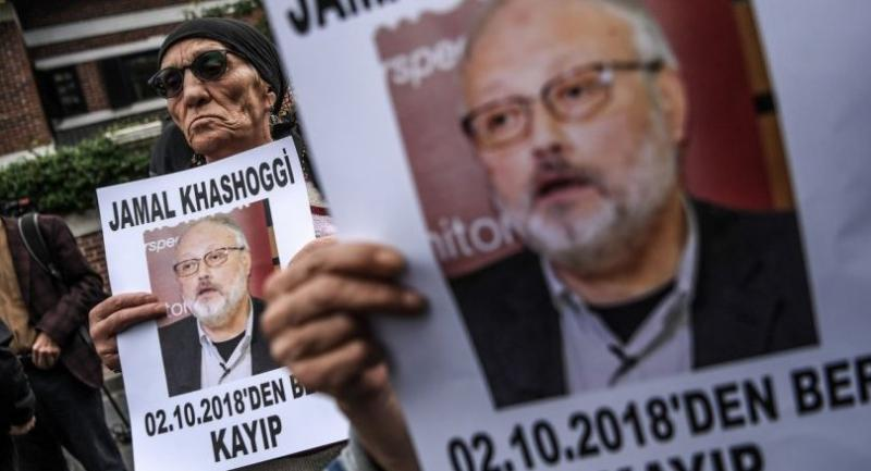 This file photo taken on October 9, 2018 shows protesters holding portraits of missing journalist and Riyadh critic Jamal Khashoggi during a demonstration in front of the Saudi Arabian consulate in Istanbul./AFP