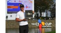 Brooks Koepka of the US poses with the trophy during the awards ceremony after winning the CJ Cup golf tournament at Nine Bridges golf club in Jeju Island.
