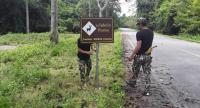 Photo by Mana Phermpool  The forest rangers are installing the wildlife caution traffic sign on the side of Ban Krang-Panoen Thung Road inside Kaeng Krachan National Park, which will be reconstructed next month.