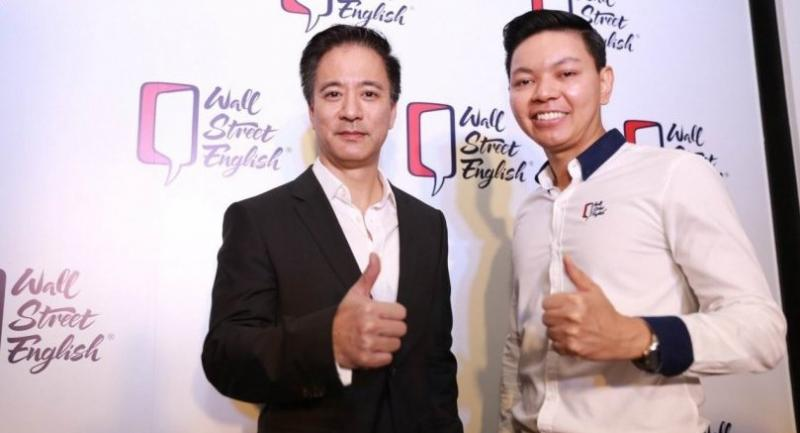 Matthew Kichodhan, left, chairman of Wall Street English Thailand, and Olarn Phirintharangkoon, chief executive officer, pose at a recent media briefing to announce the company's business expansion.
