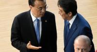 China's Premier Li Keqiang (L) gestures as he speaks with Japan's Prime Minister Shinzo Abe as they arrive to pose for a family photograph during an ASEM summit at the European Council in Brussels on October 19, 2018. (Photo by JOHN THYS / AFP)