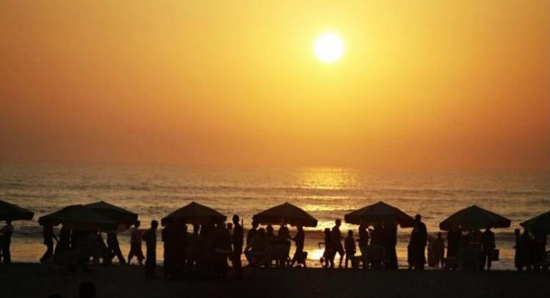 Tourists are silhouetted as the sun sets at a beach in Cox's Bazar, Chittagong. Cox's Bazar is known for its wide sandy beaches, claimed to be the world's longest natural sandy sea beach. AFP file photo