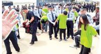 Deported suspects of VoIP scams are escorted by Chinese police to the aircraft on October 15. Many raise concerns about the increase of crime as more Chinese live and work in the Kingdom.Heng Chivoan