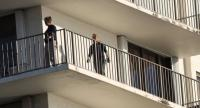FBI Agents walk on along the balcony of a condo in the building that has a possible connection to alleged bomber Cesar Sayoc and his mother on October 26, 2018 in Aventura, Florida./AFP