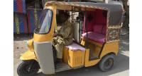 Auto-rickshaw driver Mohammad Rasheed drives his rickshaw in Korangi. //AFP
